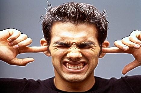 man-with-fingers-in-ears.jpg